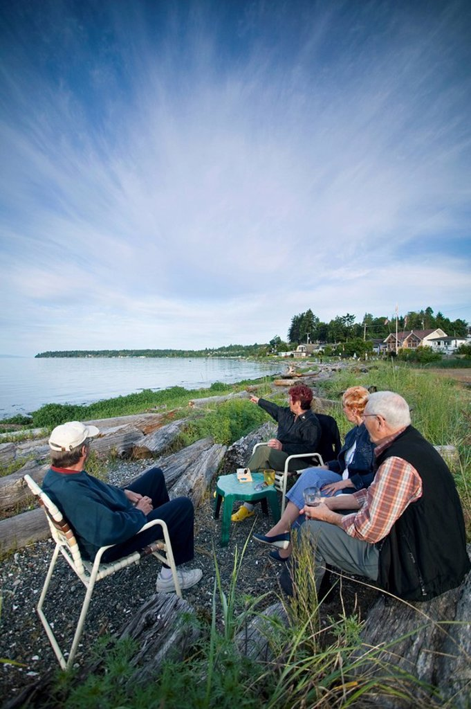 Campers enjoying a drink and each others company, Qualicum Beach, Vancouver Island, British Columbia, Canada : Stock Photo