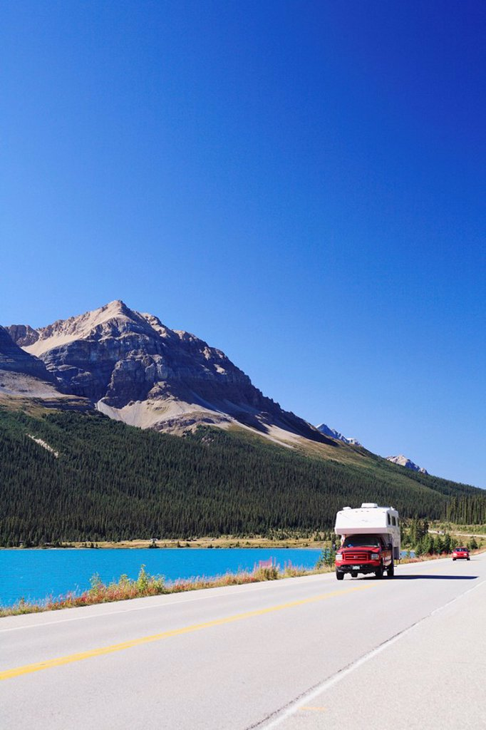 Camper and other traffic along the Icefields Parkway, Highway 93 North, near Bow Lake in Banff National Park, Alberta, Canada, part of the UNESCO Rocky Mountain World Heritage Site : Stock Photo