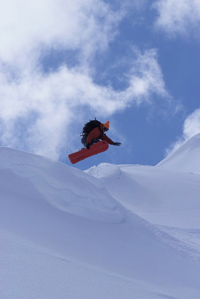 Stock Photo: 1990-12935 A snowboarder getting air in Rogers Pass, British Columbia, Canada