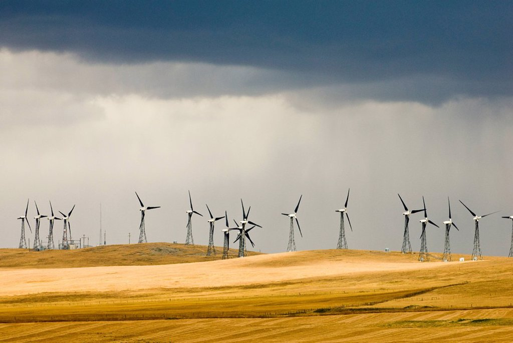 Stormy skies at a wind farm near Pincher Creek, Alberta, Canada : Stock Photo