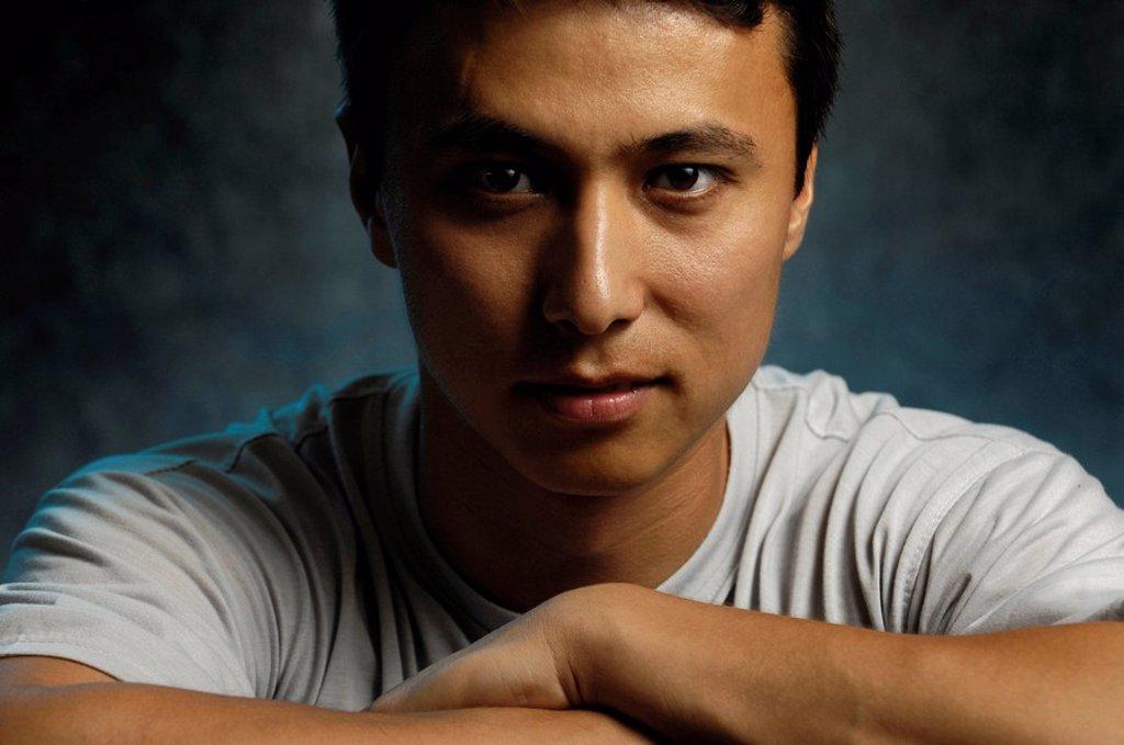 Stock Photo: 1990-13845 Young asian man around 20-25 years old Half Korean half European ethnicity Artistic expressive horizontal low-key portrait