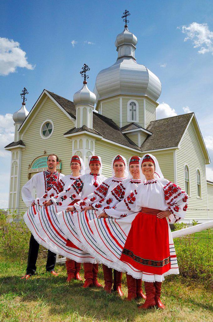 Stock Photo: 1990-14396 Ukrainian dancers pose in front of St.Vladimir´s Ukrainian Greek Orthodox Church in the Ukrainian Cultural Heritage Village, east of Edmonton, Alberta, Canada