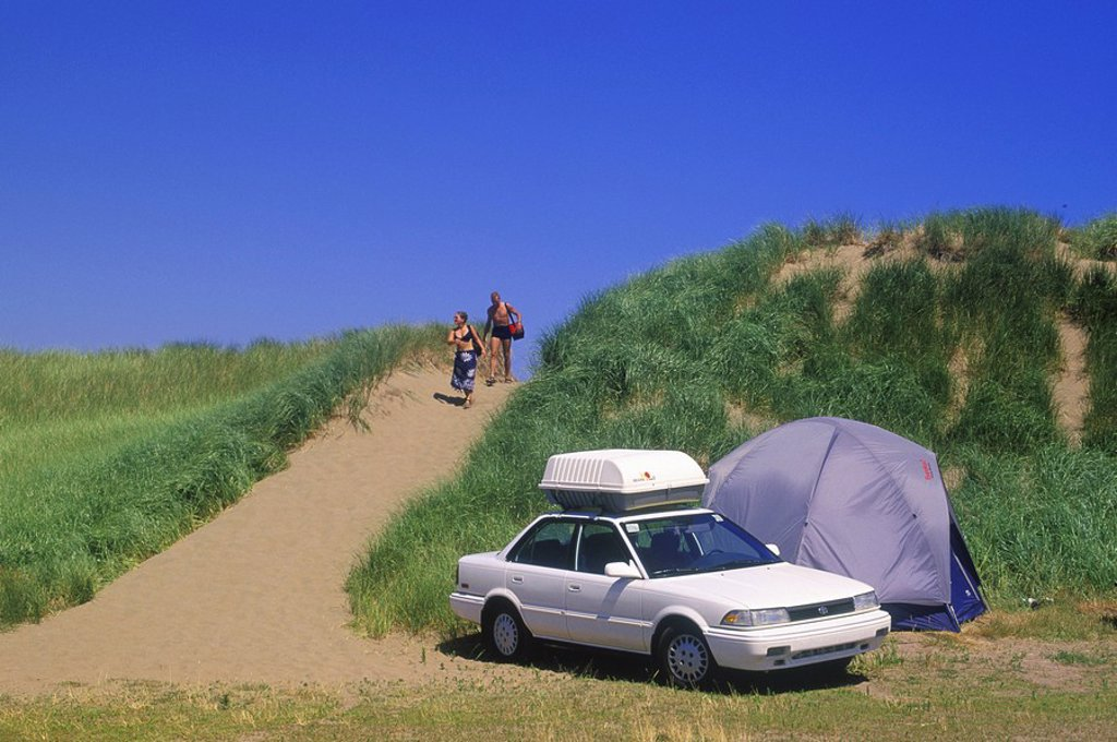Stock Photo: 1990-1484 Couple camping on beach near Northumberland Strait at Shediac, New Brunswick, Canada