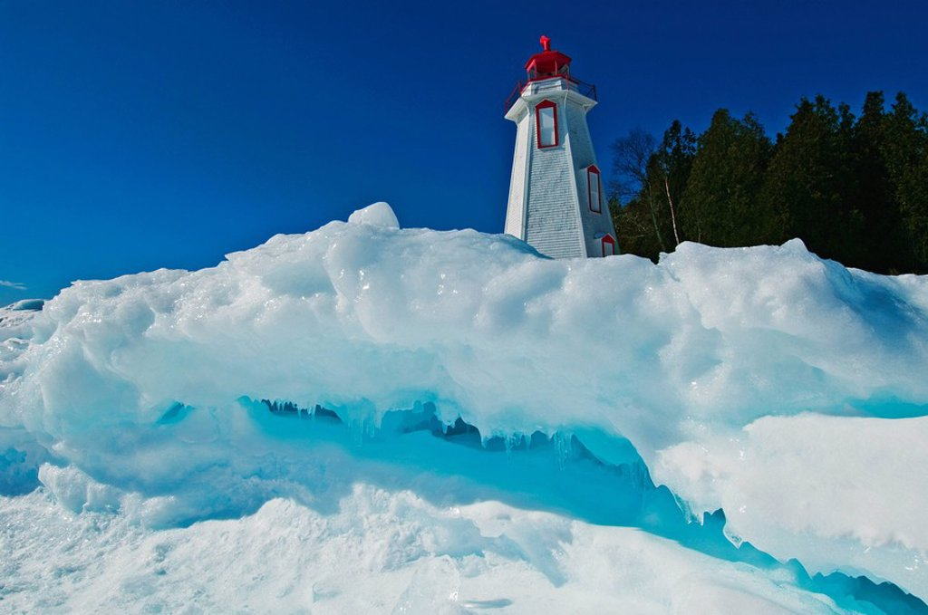 Stock Photo: 1990-14860 Lighthouse in winter at edge of Georgian Bay in Tobermory, Bruce Peninsula National Park, Ontario, Canada