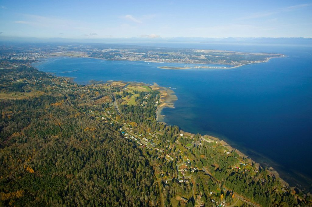 Aerial view of Royston with Comox Bay and the Comox Peninsula and Goose Spit in the background, Georgia Strait and the Coast Mountains in the distance, Comox Valley, Vancouver Island, British Columbia, Canada : Stock Photo