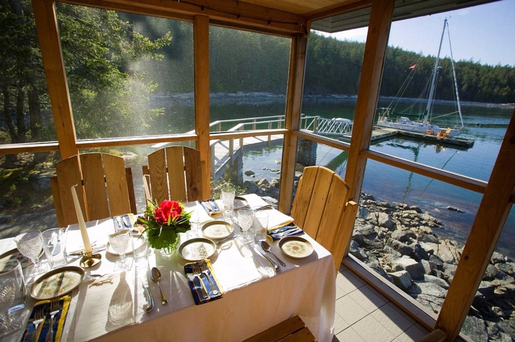 T´ai Li lodge on Cortes Island boasts intimate waterfront dining complete with a view of the sailboats, Cortes Island, British Columbia, Canada : Stock Photo