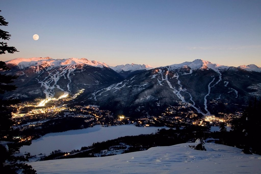 Whistler Village at dawn with Blackcomb Mountain and Whistler Mountain beyond, British Columbia, Canada : Stock Photo