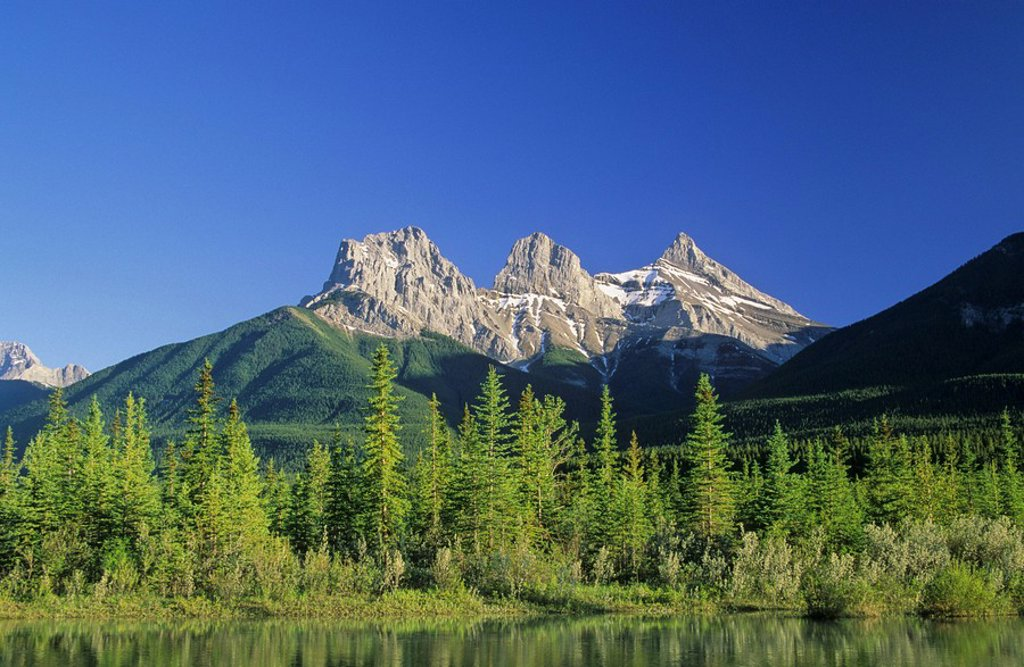 Stock Photo: 1990-16513 The Three Sisters and the Bow River in Canmore, Alberta, Canada