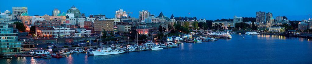 A view towards Victoria´s waterfront from across the Johnson bridge affords the viewer a different perspective incorporating Victoria´s historical buildings intermingled between modern development. Victoria, Vancouver Island, British Columbia, Canada. : Stock Photo
