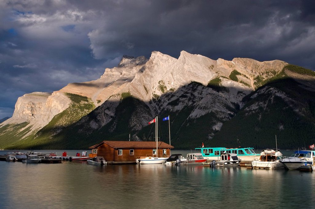 Sunset at Lake Minnewanka boathouse in Banff National Park, Alberta, Canada : Stock Photo