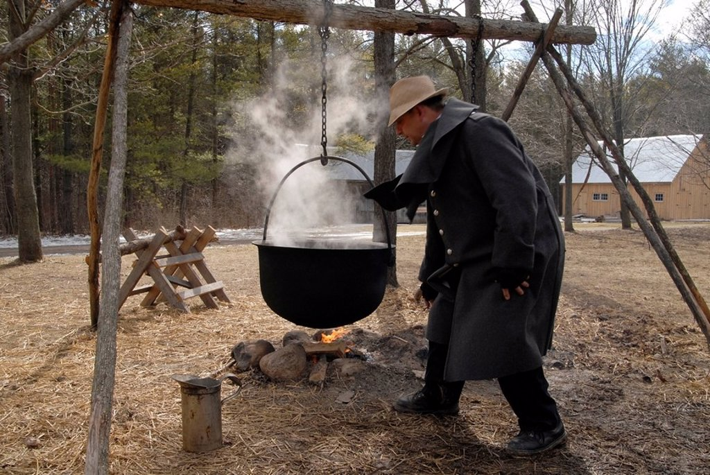 Demonstration of syrup production in the traditional way, Westfield Heritage Village, Ontario, Canada : Stock Photo