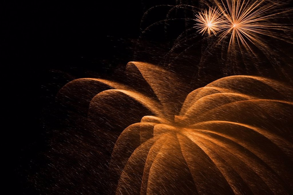 Stock Photo: 1990-19013 Gold and white fireworks in the night sky