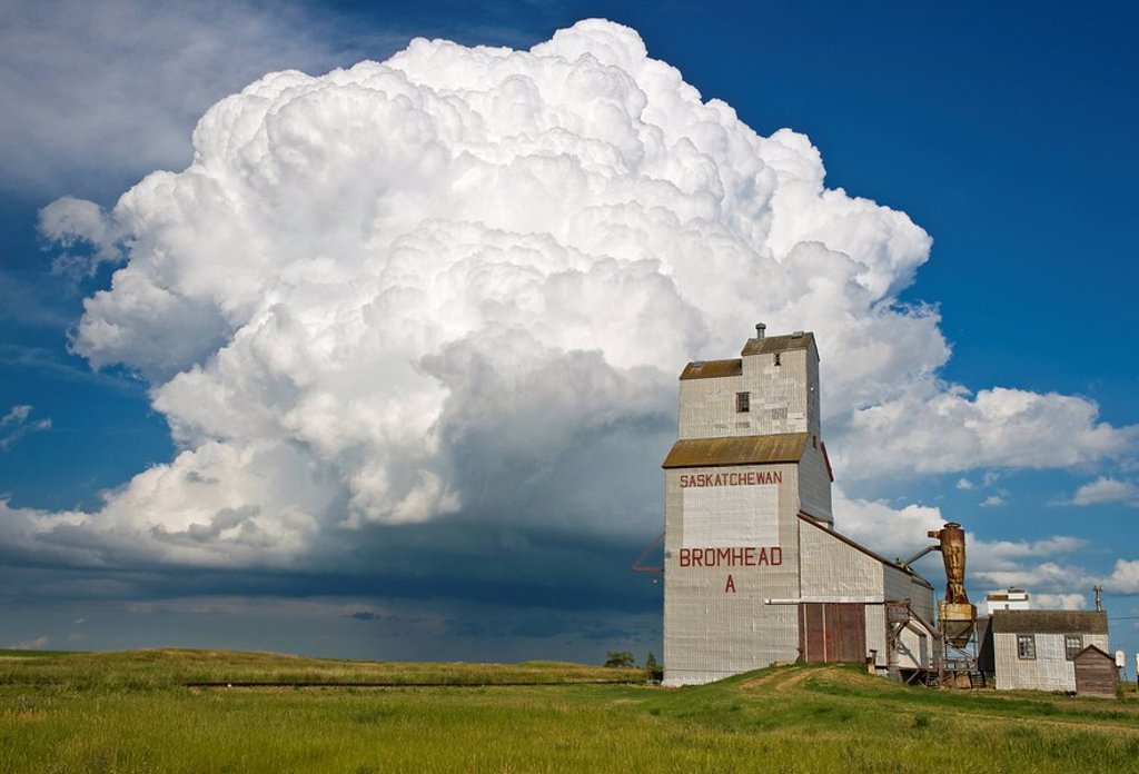 Stock Photo: 1990-19044 Grain elevator and cumulonimbus supercell, Bromhead, Saskatchewan, Canada