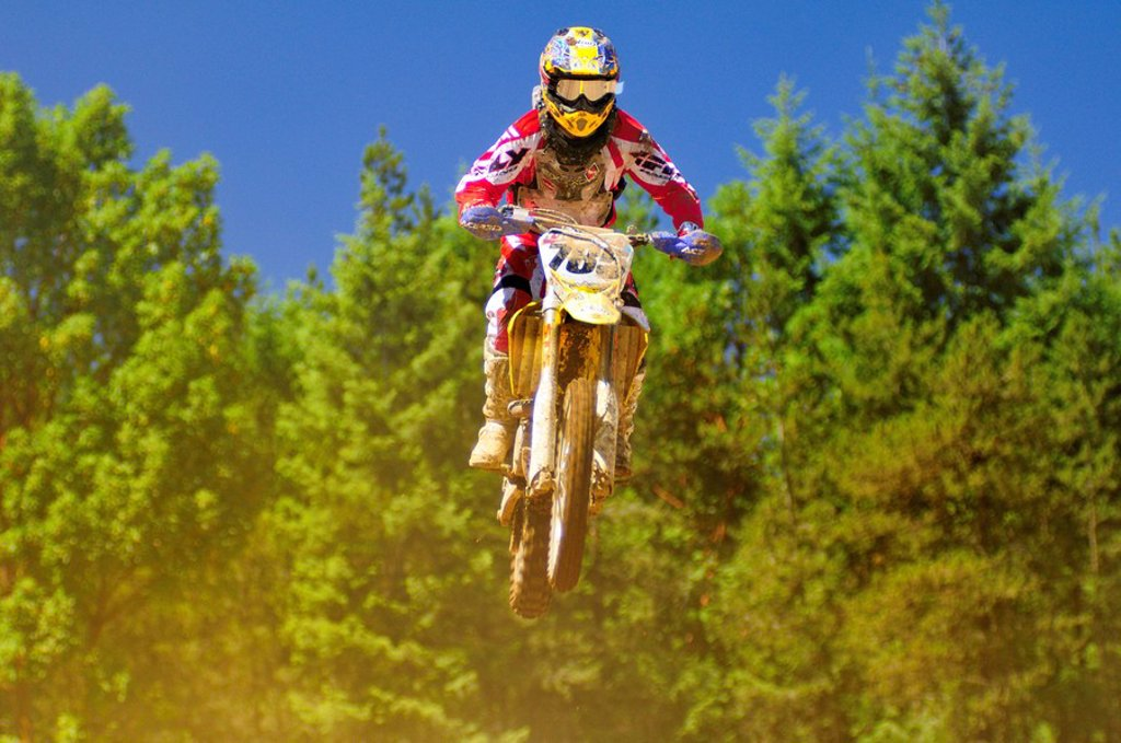 Stock Photo: 1990-20635 motocross racer at a jump during motocross action at the Wastelands in Nanaimo, BC.