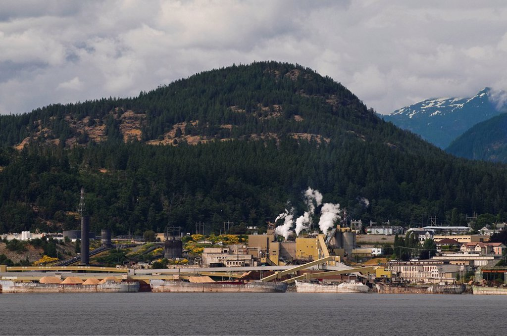 Stock Photo: 1990-20820 Powell River´s Pulp and Paper Mill. The mill was at one time the largest pulp and paper mill in the world. At its peak, one in every 25 newspapers in the world was printed on paper from the Powell River mill. However, since then it has significantly cut b