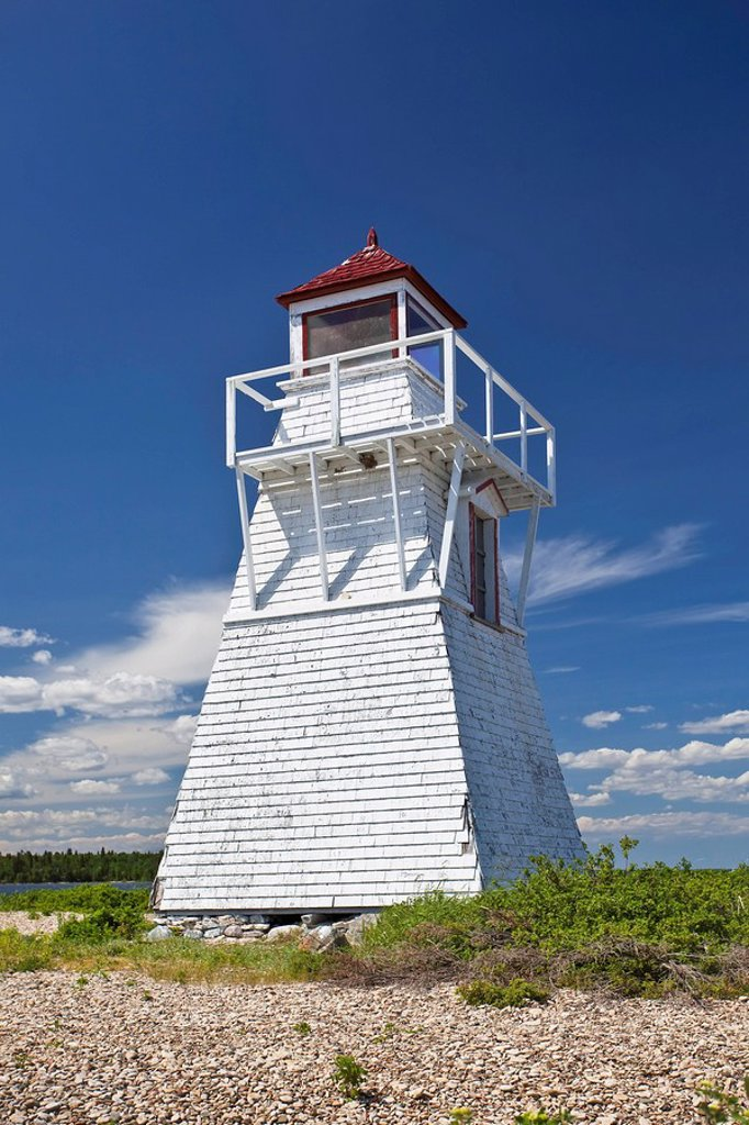 Stock Photo: 1990-20862 Gull Harbour Lighthouse on Lake Winnipeg. No longer in operation, it was replaced with a modern automated lighthouse. Hecla Island Provincial Park, Manitoba, Canada.