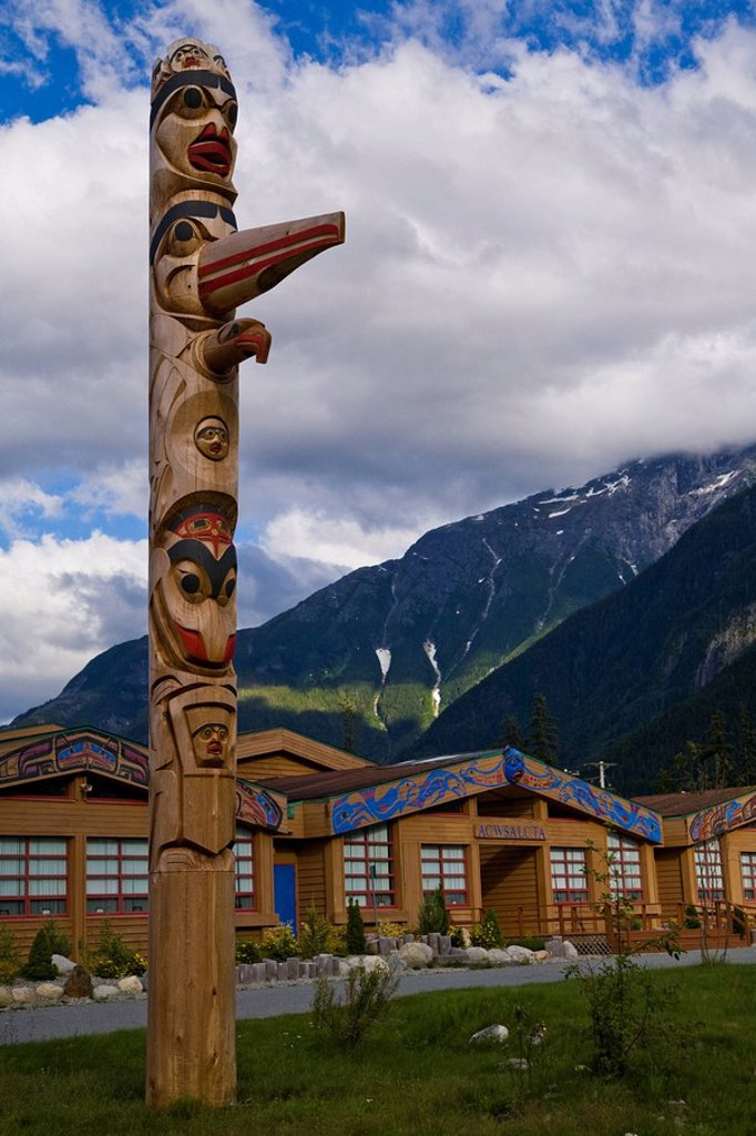 Stock Photo: 1990-21785 Totem Pole in front of a School, Bella Coola Valley, BC, Canada