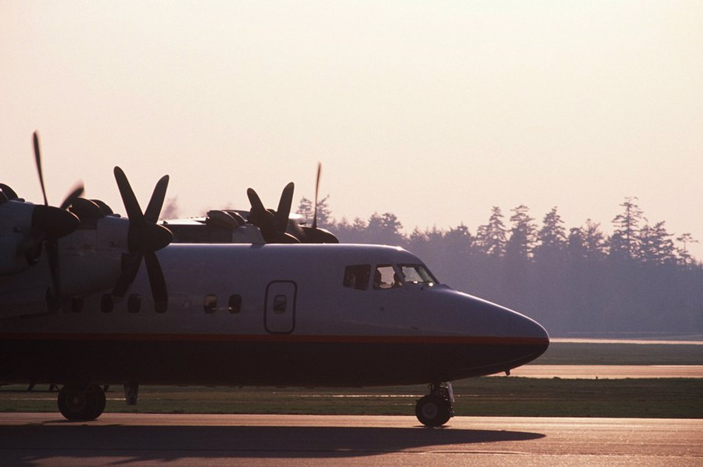 Victoria International Airport, aircraft at sunrise, Vancouver Island, British Columbia, Canada : Stock Photo