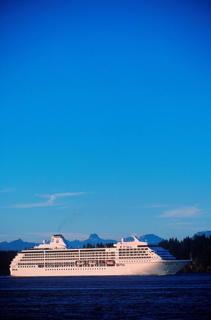 Stock Photo: 1990-22396 Passenger cruise ship in Johnstone Stait, near Campbell River, Quadra Island behind, British Columbia, Canada