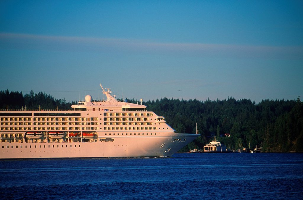 Stock Photo: 1990-22397 Passenger cruise ship in Johnstone Stait, near Campbell River, Quadra Island behind, British Columbia, Canada