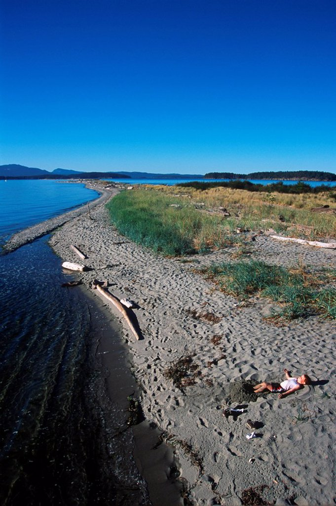 Stock Photo: 1990-23136 Sidney Spit , Gulf Islands National Park, boy plays on beach, British Columbia, Canada