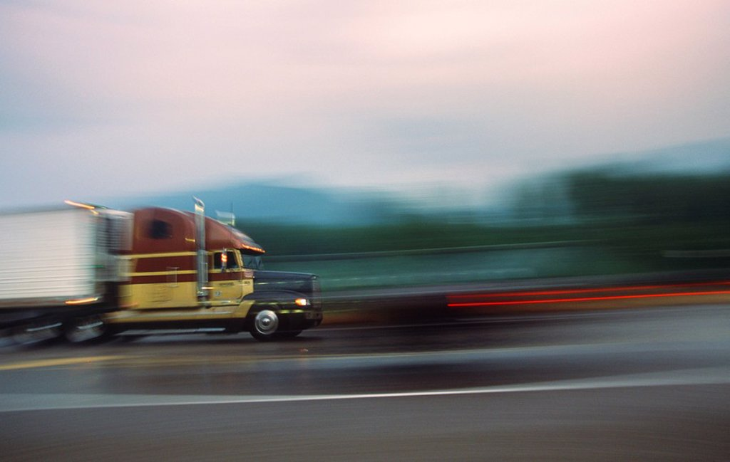 Blurred shot of transport truck on highway, British Columbia, Canada : Stock Photo