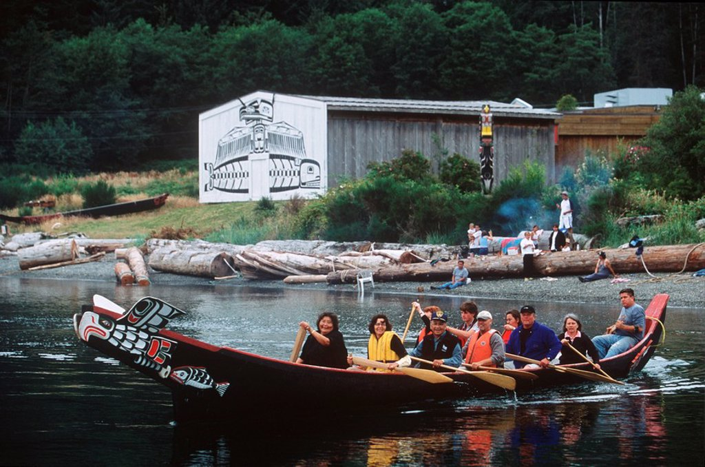 Stock Photo: 1990-23701 Alert Bay, U´mista Cultural Center visitors paddle traditional canoe, British Columbia, Canada