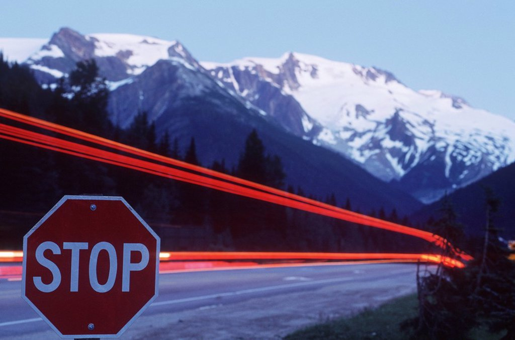 Rogers Pass, time exposure of highway at stop sign, British Columbia, Canada : Stock Photo