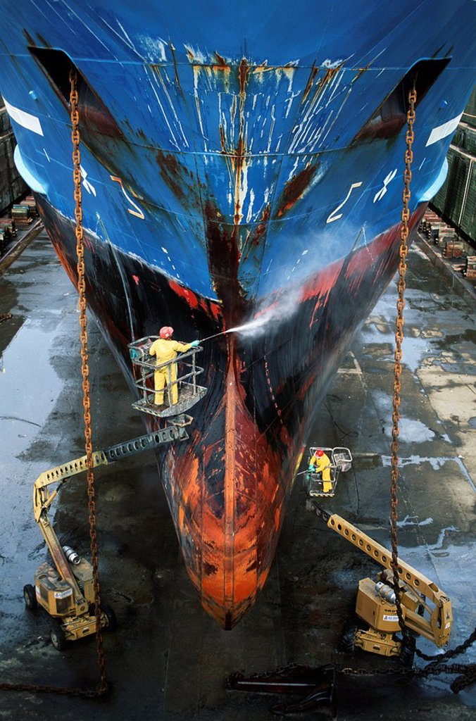 shipyard workers power wash hull of ship, Victoria, Vancouver Island, British Columbia, Canada : Stock Photo