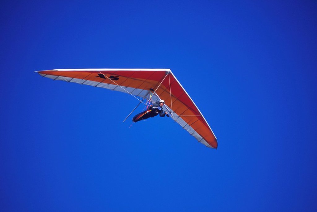 Hang glider in flight on blue sky, British Columbia, Canada : Stock Photo