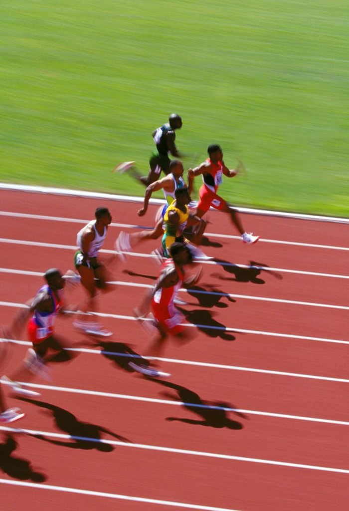 100 M men´s sprint at track competion  Motion blur, rust track, British Columbia, Canada : Stock Photo