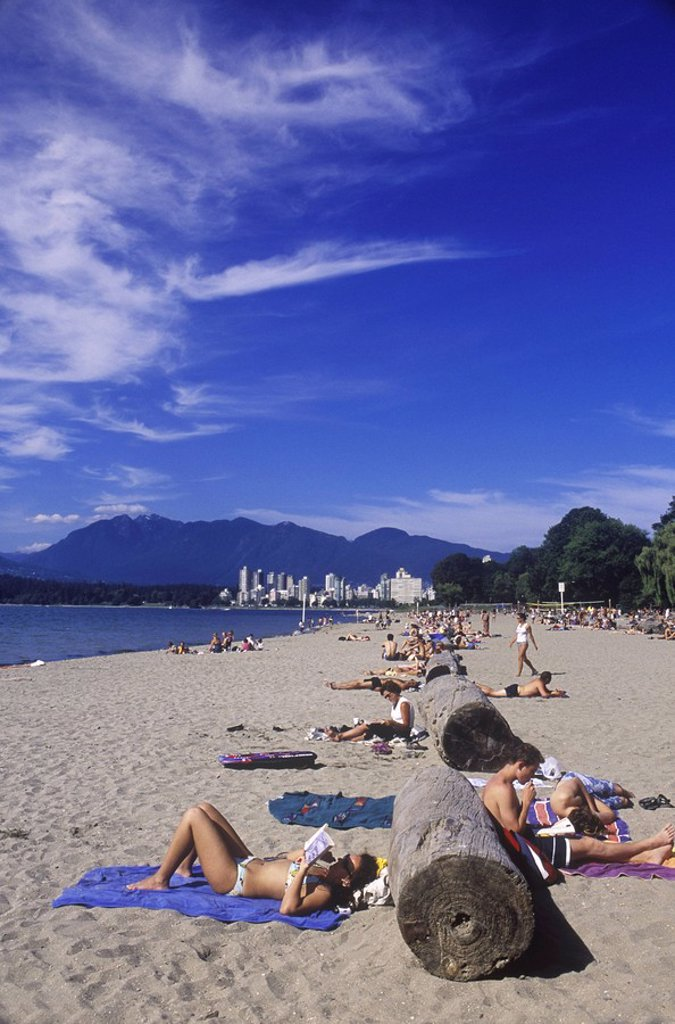 Stock Photo: 1990-24491 People sun tanning on Kitsilano Beach, English Bay, Vancouver, British Columbia, Canada