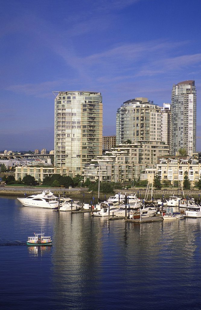 View across False Creek to condos from Cambie bridge with aquabus, Vancouver, British Columbia, Canada : Stock Photo