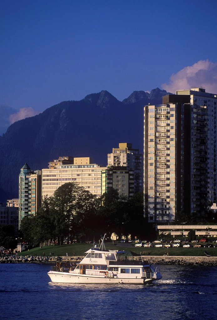 View across English Bay to West End condos with yacht, Vancouver, British Columbia, Canada : Stock Photo