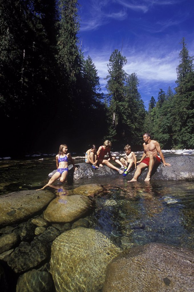 Englishman River Provincial Park  Family swimming and sunning on rocks in river, British Columbia, Canada : Stock Photo