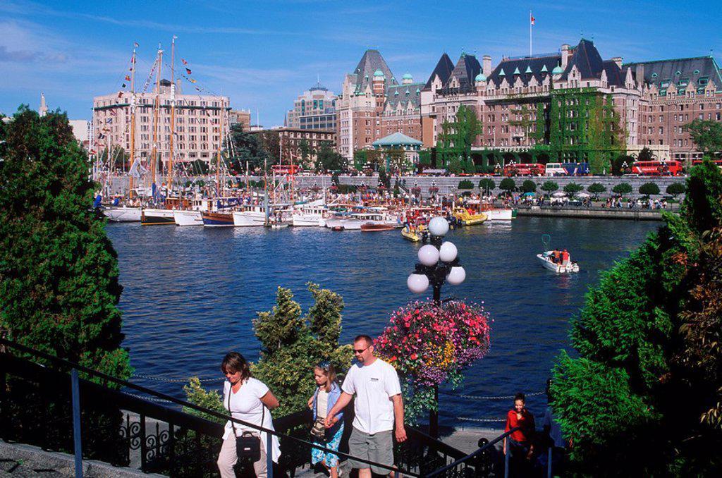 Tourists walking around the Inner Harbour, Victoria, Vancouver Island, British Columbia, Canada : Stock Photo