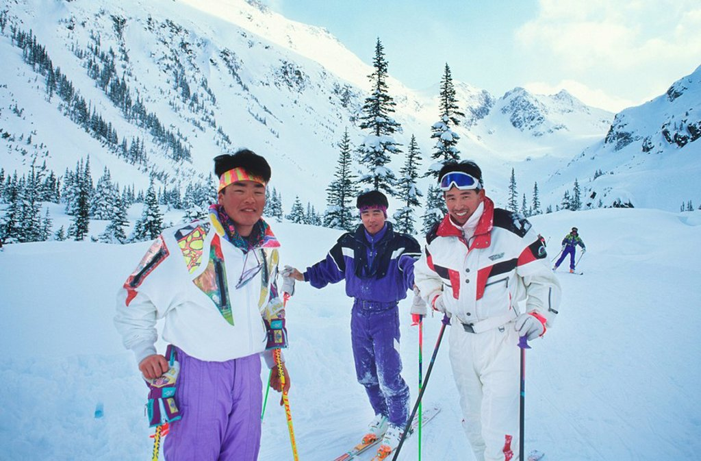Three japanese men pose for rest at Blackcomb glacier bowl ski out, Whistler, British Columbia, Canada : Stock Photo