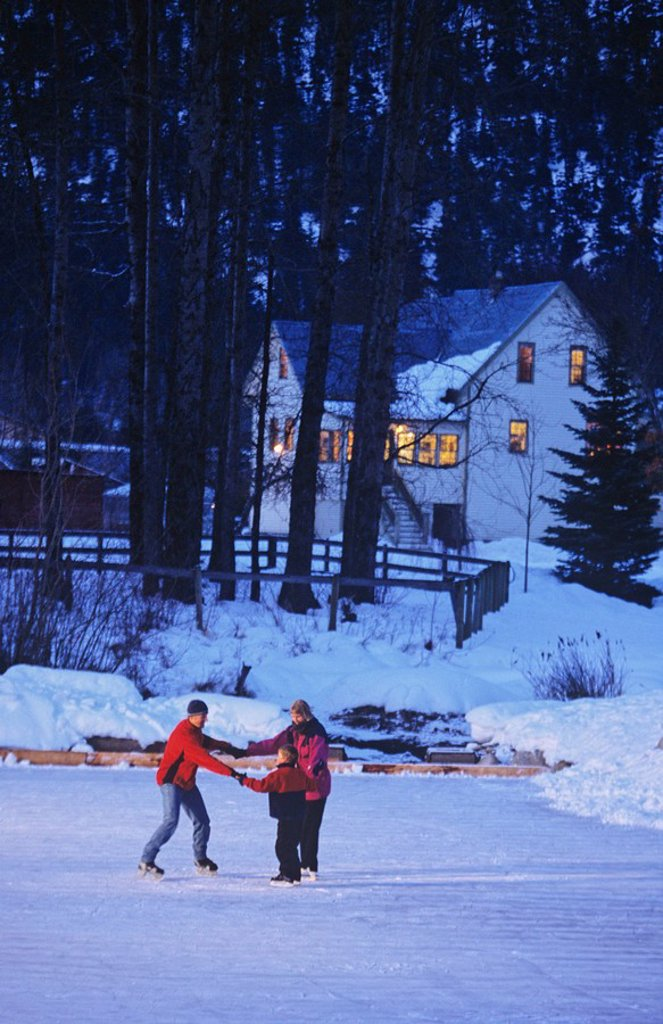Family skates on outdoor ice rink, Pemberton, British Columbia, Canada : Stock Photo