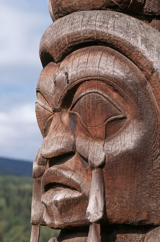 Detail of Totem pole face, British Columbia, Canada : Stock Photo