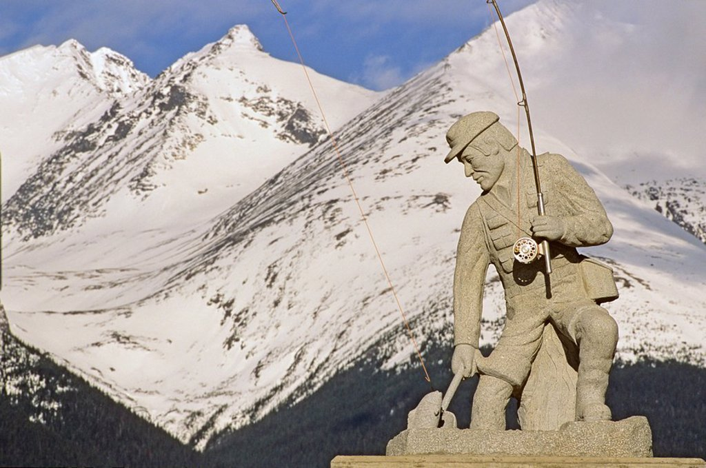 Flyfisherman statue with Hudson Bay mountain in background, Smithers, British Columbia, Canada : Stock Photo