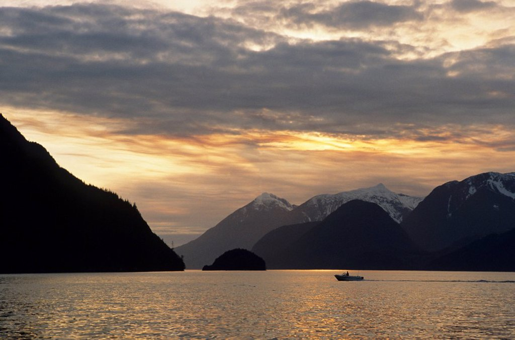 Stock Photo: 1990-27732 Boat at sunset, Knight Inlet, British Columbia, Canada
