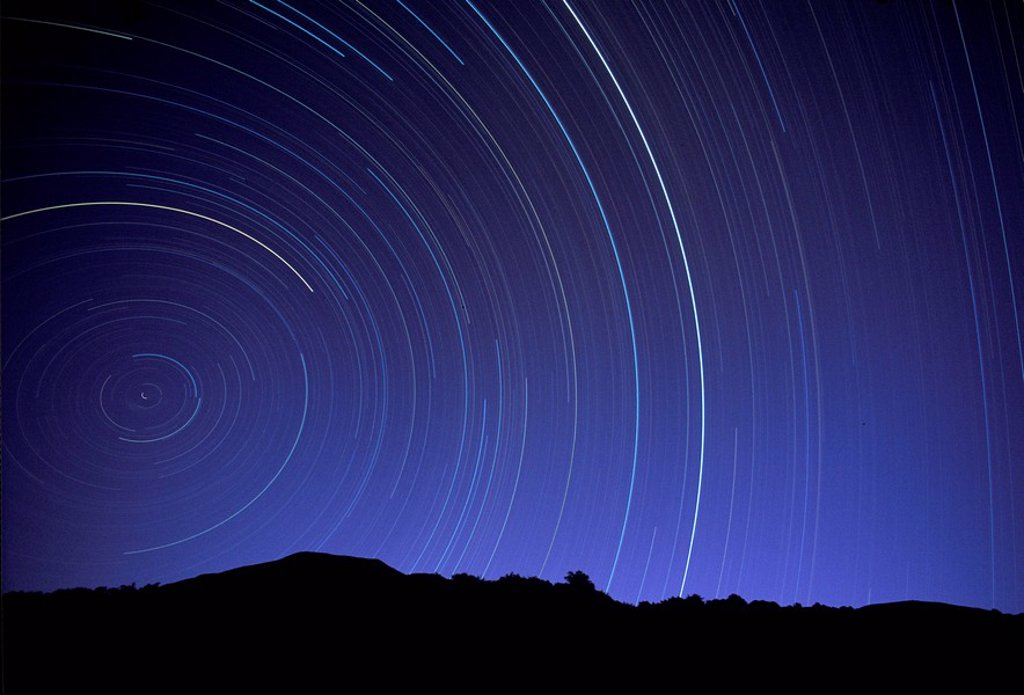 Star trails over mountain range in utah : Stock Photo