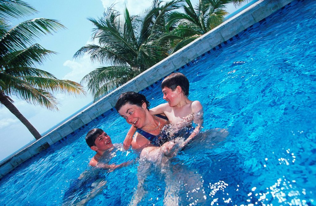 Mexico, Yucatan Peninsula, mother and two sons at Carribean resort at Isla Mujeres : Stock Photo