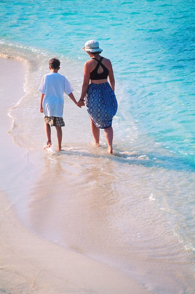 Stock Photo: 1990-29090 Mexico, Yucatan Peninsula, Carribean resort at Isla Mujeres, woman and son walk down beach