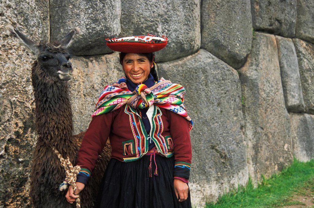 Stock Photo: 1990-29455 Peruvian woman with llama, Sacsayhuaman, just north of Cusco, Sacred Valley, Peru