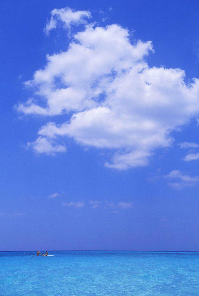 Cuba, Veradaro, cumulus cloud over azure water of carribean sea : Stock Photo