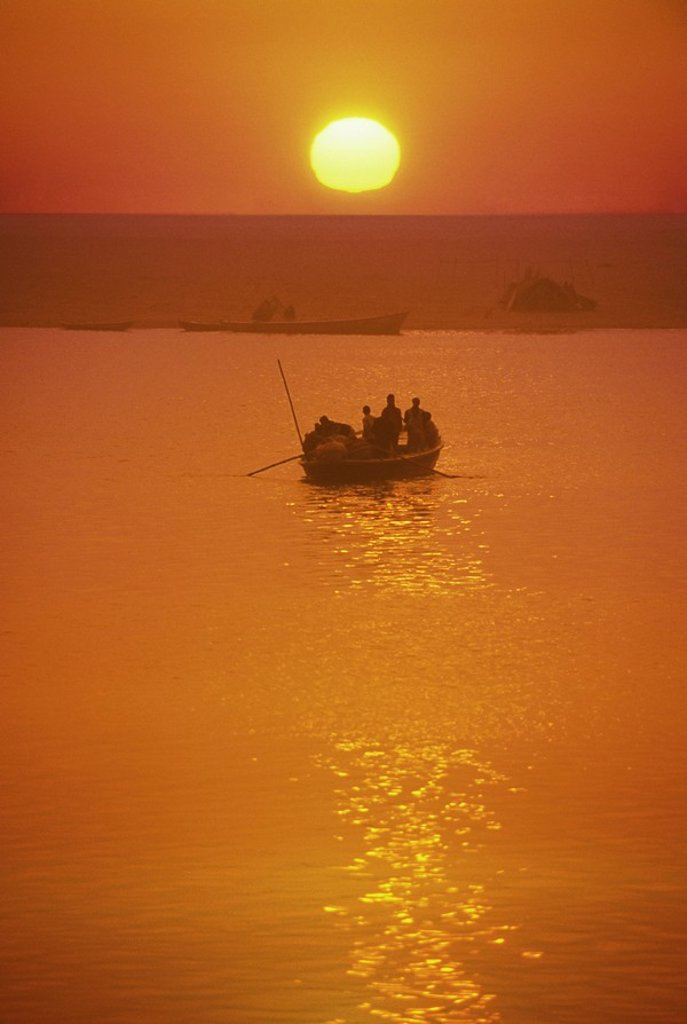 Stock Photo: 1990-29743 India, Varanasi, Ganges River boat load of pilgrims