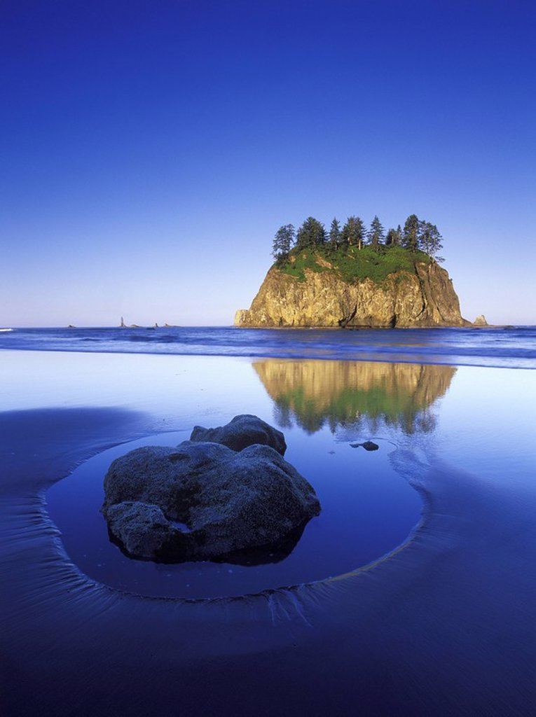 Stock Photo: 1990-30230 USA, Washington State, Olympic National Park, rock in sand on Shi Shi Beach with sea stacks