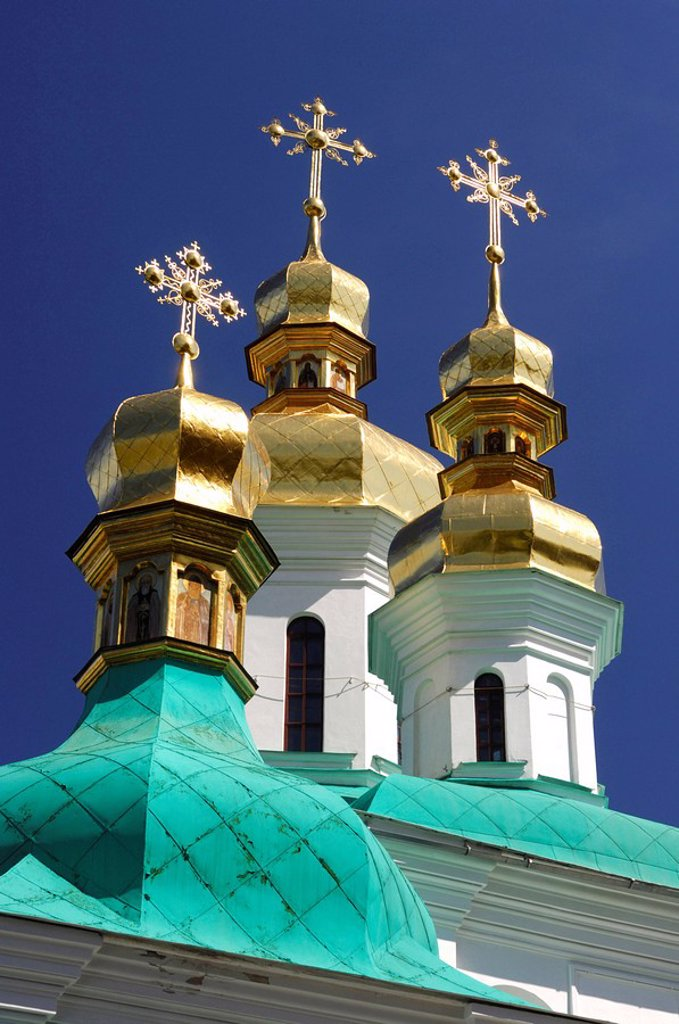 The Mother of God Christmas church golden cupola with crosses near the far caves of Kiev pechersk lavra - Cave monastery in Kiev Ukraine Eastern Europe Architecture in Ukrainian baroque architectural style : Stock Photo