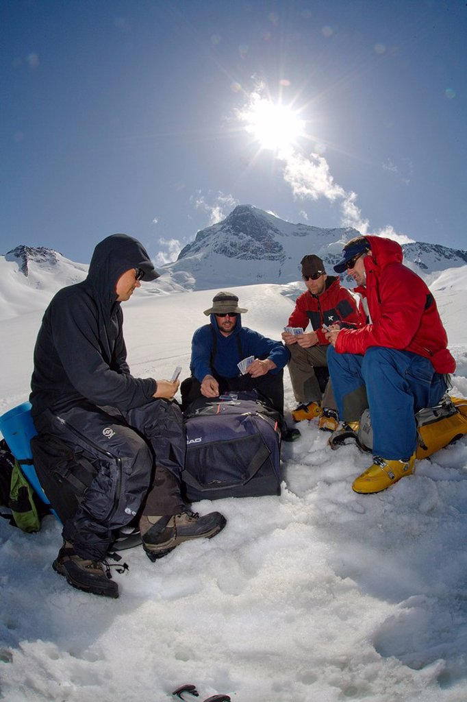 playing cards waiting for helicopter on Mt Waddington, BC : Stock Photo